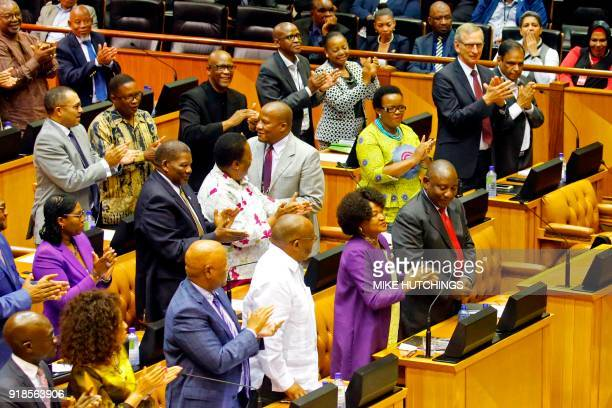 Members of Parliament and South African National Assembly speaker Baleka Mbete applaud former South African Deputy president Cyril Ramaphosa during a...