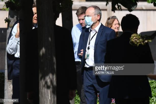 Members of Parliament are seen queuing in a courtyard on the parliamentary estate to vote on the motion of 'Proceedings during the pandemic', in the...