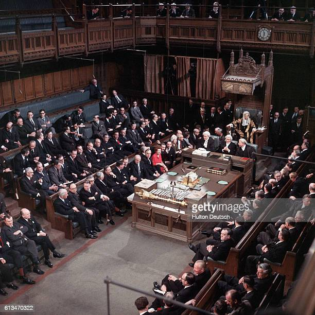 Members of Parliament assembled in the House of Commons for the state opening of the bicameral parliament which is to be televised for the first time
