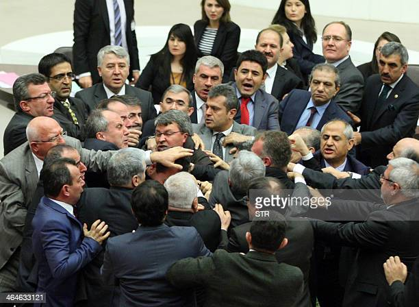 Members of parliament from the ruling Justice and Development Party and the main opposition Republican People's Party scuffle during a debate at a...