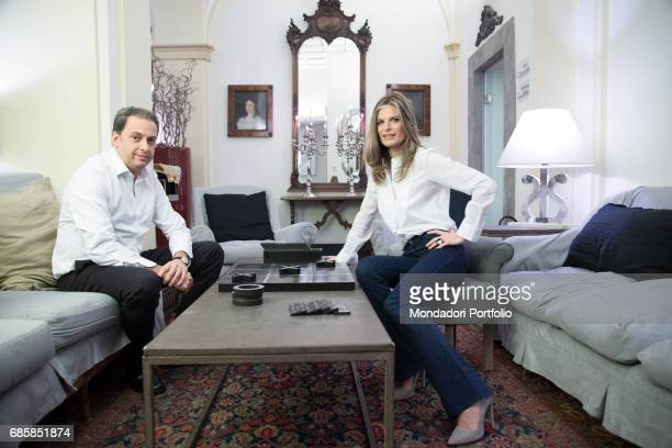 Members of Parliament Laura Ravetto and Dario Ginefra soon to be married sitting in their living room Rome Italy 2nd March 2016