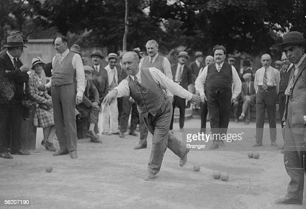Members of Parliament playing bowls at the porte de Versailles In the center in the background Henri Pate Paris 19251930