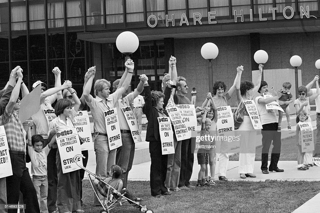 Members of PATCO, the air traffic controllers union, hold hands and raise their arms as their deadline to return to work passes. All strikers were fired on the order of President Reagan on August 5, 1981.