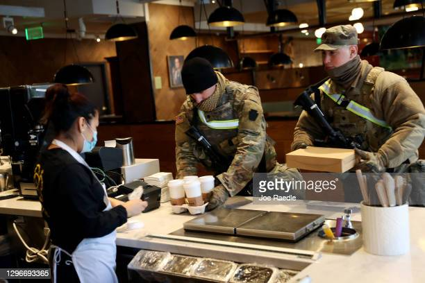 Members of Pennsylvania 112th Infantry Regiment National Guard are served coffee by Janet Barrera at the Farmers & Distillers restaurant on January...