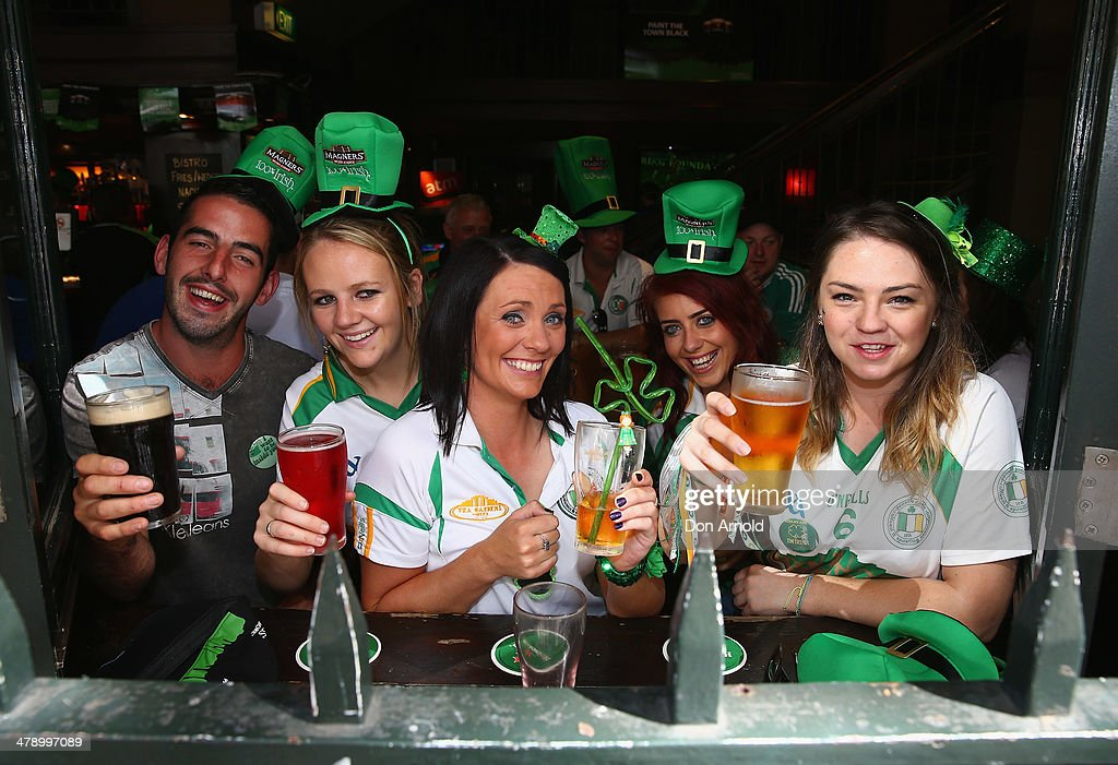 Members of Penrith Gaels Football Club celebrate St Patrick's Day inside the Three Wise Monkeys Hotel on March 16, 2014 in Sydney, Australia. St Patrick's Day is an annual religious and cultural commemoration of the widely recognised patron saint of Ireland, Saint Patrick. March 17th, is a public holiday in Northern Ireland and the Republic of Ireland but is celebrated in many countries around the world where Irish diaspora have settled.