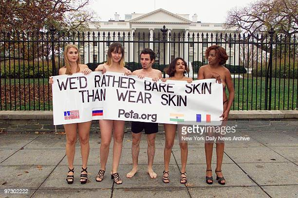 Members of People for the Ethical Treatment of Animals nearly bare their all to protest the use of leather in coats shoes and other accessories in...