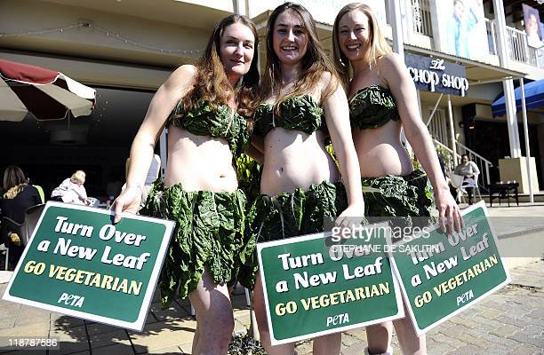 Members of People for the Ethical Treatment of Animals wearing real lettuce leaves hold signs that read Turn Over a New Leaf Go Vegetarian on June 28...