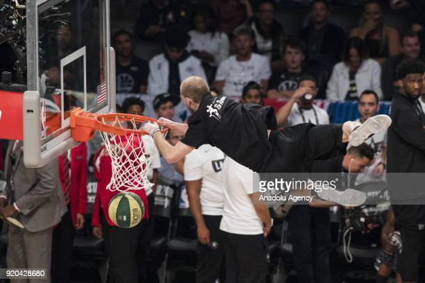 Members of performance team perform for the crowd ahead of the 2018 NBA AllStar Game at the Staples Center in Los Angeles California on February 18...