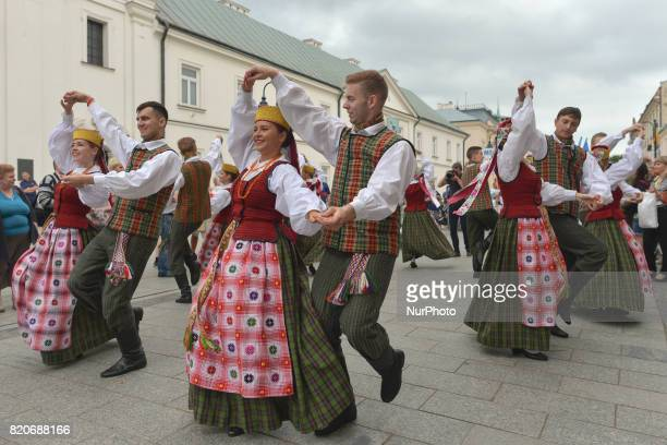 Members of 'Perla' from Lituania during the traditional parade walk through the renovated 3rd May Street on the opening day of the 17th edition of...