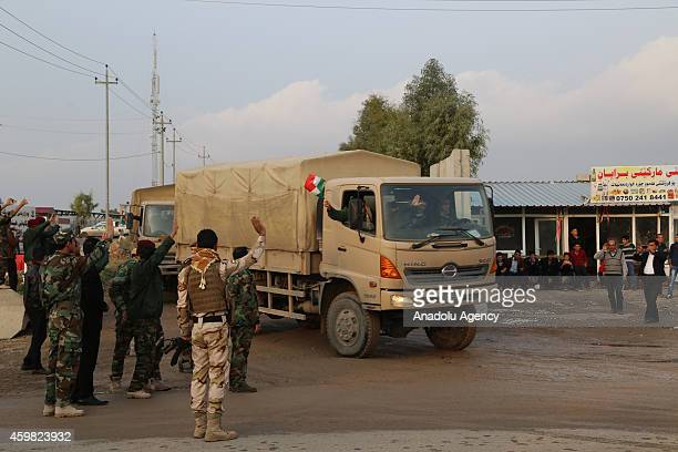 Members of Peshmerga Forces leave their base in Arbil Iraq to go to the Kobani town of Syria on December 02 2014 Iraqi Kurdish Regional Government is...