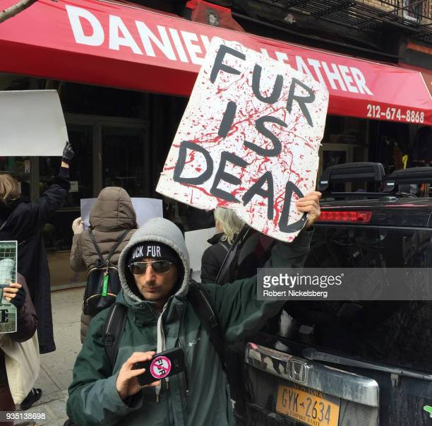 Members of PETA, People for the Ethical Treatment of Animals, protest outside a clothing store they claim is selling fur jackets and clothing March...