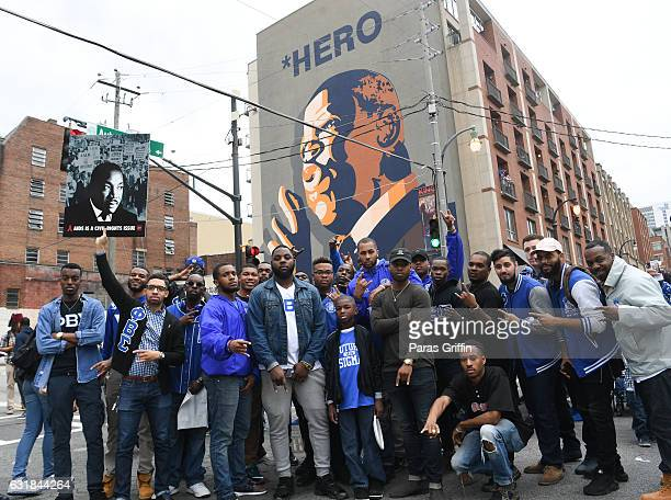 Members of Phi Beta Sigma Fraternity Inc pose in front of John Lewis mural during the 2017 Martin Luther King Jr Day March and Rally at the MLK...