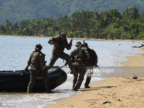Members of Philippine navy special operations group take position as they secure the landing site during a simulation of a disaster drill as part of...