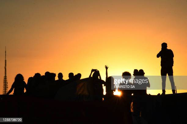 Members of political parties and civil society organizations protest outside the National Congress in Brasilia, after a request for the impeachment...