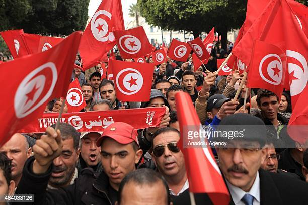 Members of political parties and civil society organizations stage a demonstration called 'joint march against terror' in Tunis Tunisia on February...