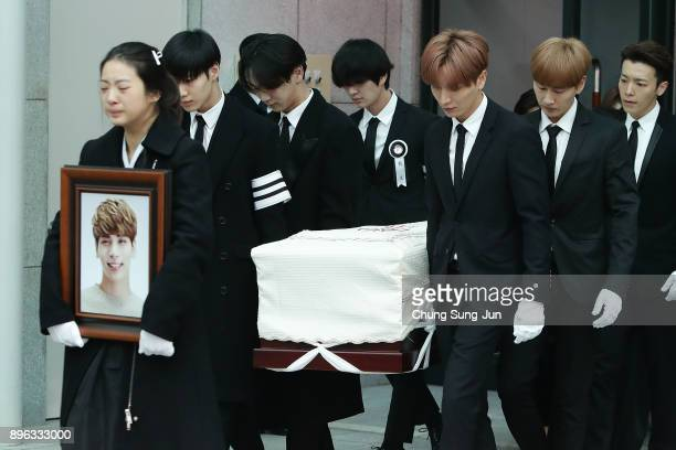 Members of pop Idol SHINee and Super Junior carry the coffin containing the body of Jonghyun of SHINee during the funeral at the hospital on December...