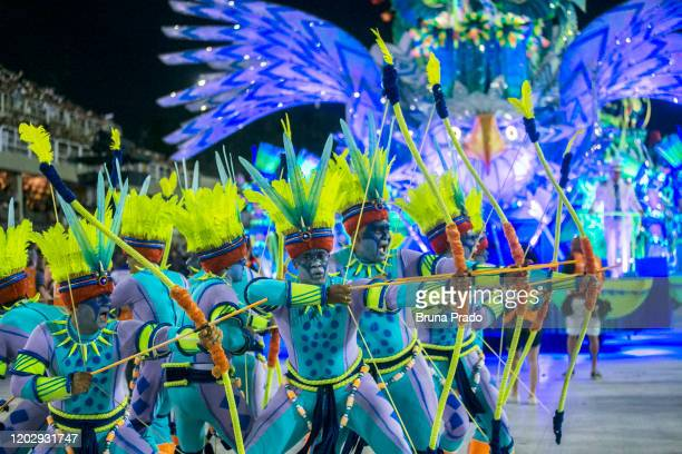 Members of Portela samba school dressed as archers perform during the first night of 2020 Rio's Carnival Parades at the Sapucai Sambadrome on...