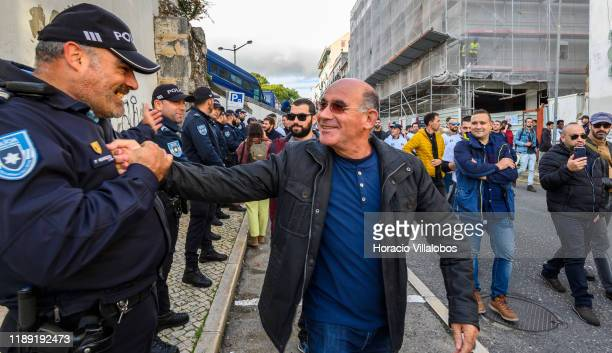 Members of Portuguese Police PSP and National Republican Guard GNR are greeted by policemen on duty while arriving in the Assembleia da Republica to...