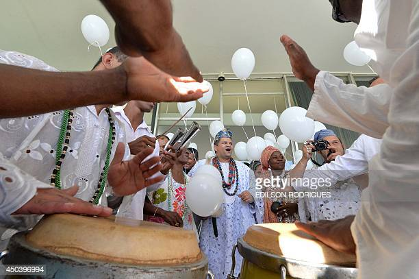Members of Povo de Santo an association which includes leaders of Brazil's most traditional Candomble and Umbanda Houses take part in a demonstration...