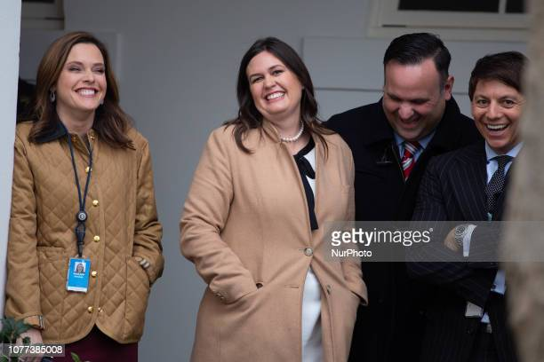 Members of President Donald Trump's staff including Press Secretary Sarah Sanders share a laugh during a press conference following a bipartisan...