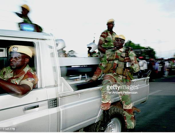 Members of President Robert Mugabes presidential security following him June 23 2000 after a election rally in Harare Zimbabwe days before the...