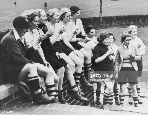 Members of Preston Ladies' Football Club take a break to enjoy their milk ration Preston Lancashire 30th March 1939