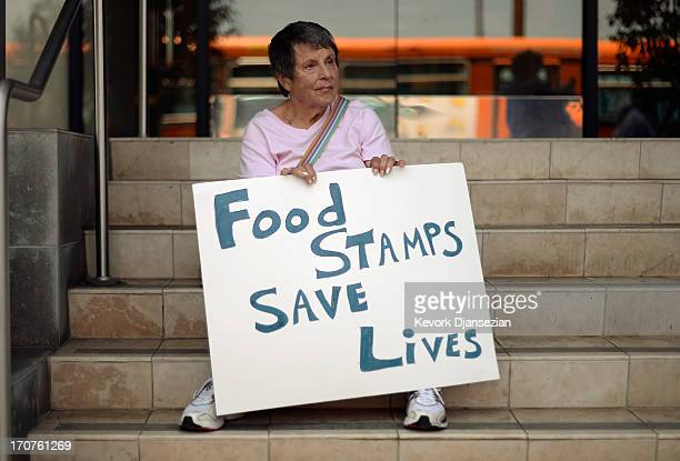 Members of Progressive Democrats of America and other activists hold a rally in front of Rep Henry Waxman's office on June 17 2013 in Los Angeles...