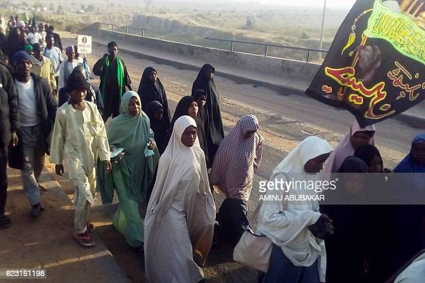 Members of proIran Shiite group the Islamic Movement of Nigeria gather on the outskirts of the northern Nigerian city of Kano on November 14 during a...