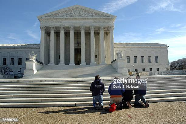 Members of ProLife Wisconsin kneel to pray during a March for Life prayer vigil in front of the Supreme court building on January 22 2006 in...