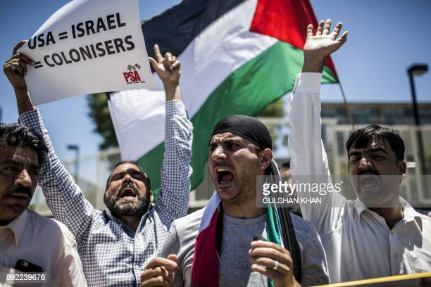 TOPSHOT Members of proPalestinian groups the Young Communist League the Ahmed Kathrada Foundation civil society groups and others demonstrate outside...