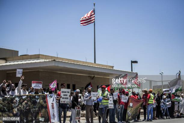 Members of proPalestinian groups the Young Communist League the Ahmed Kathrada Foundation civil society groups and others demonstrate outside the US...