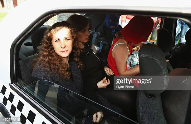 Members of protest group Pussy Riot leave after a press conference on February 20 2014 in Sochi Russia
