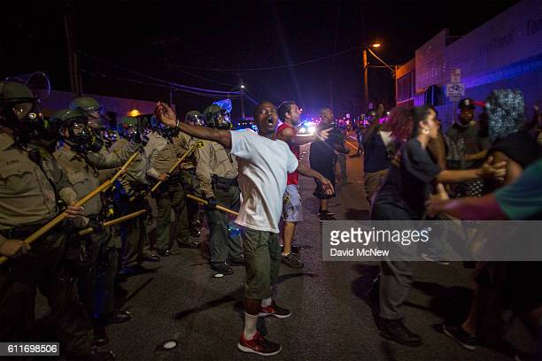 Members of protest security defuse a potentially volatile moment by stepping between protesters and Sheriffs deputies to maintain a peaceful protest...