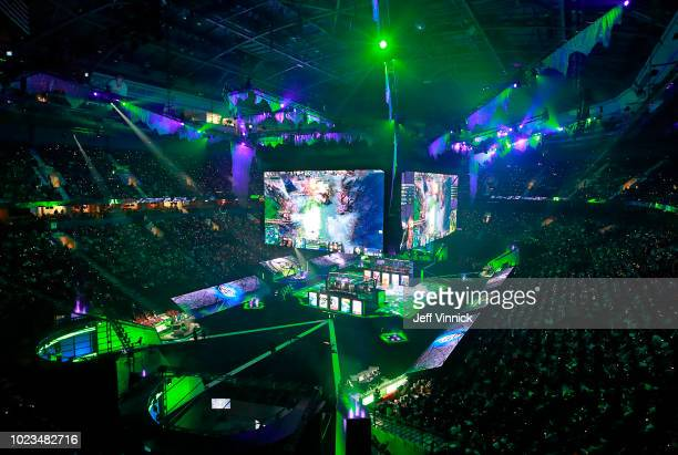 Members of PSG.LGD and OG sit in their booths as they play in their grand final Dota 2 match on Day 6 of The International 2018 at Rogers Arena on...