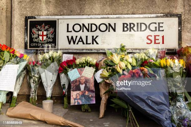 Members of public leave flowers and goodbye notes at the scene of November 29 2019 London Bridge terror attack in London England December 1 2019...
