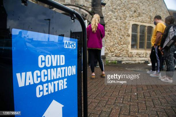 Members of public queue outside a Covid-19 vaccination centre in London.