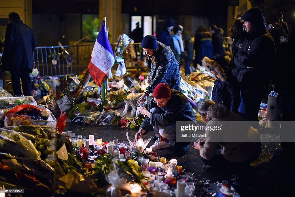 Tributes And Reaction To Paris Terror Attacks After Gunmen Kill 17 People : News Photo