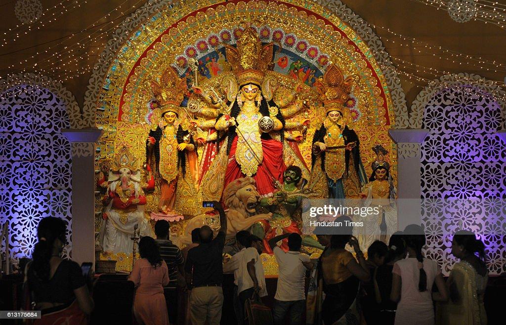 Members of Purbapalli Durgabari Samiti and devotees celebrate the Durga Puja in sector15 community centre on October 7 2016 in Gurgaon India Durga...
