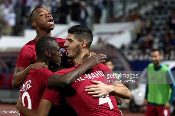 Members of Qatar's national football team celebrate after scoring a goal against Yemen during their 2017 Gulf Cup of Nations football match at the...