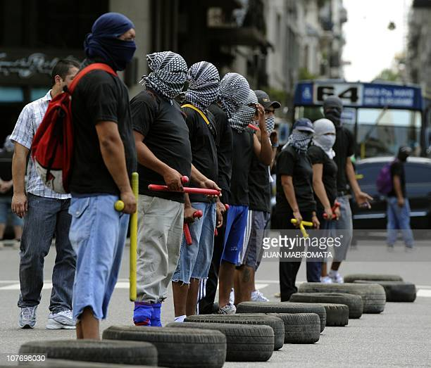 Members of Quebracho organization block 9 de Julio avenue on December 20 during a demonstration in memory of picketer Petete Almiron who died during...