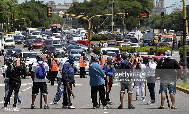 Members of Quebracho organization block 9 de Julio avenue on December 20, 2012 in Buenos Aires, during a demonstration on the 11th anniversary of the...