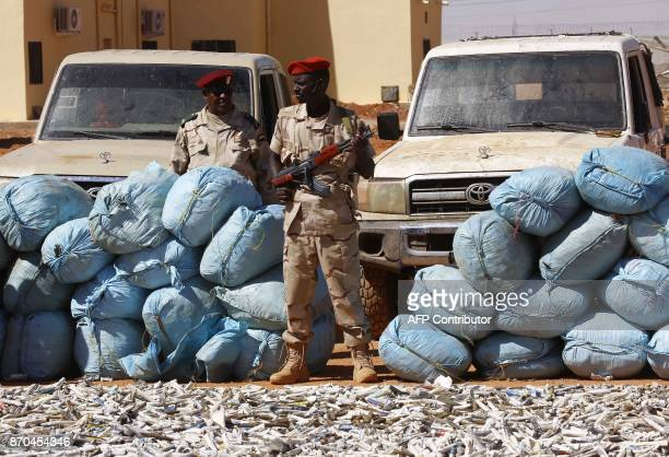 Members of Rapid Support Forces Sudans controversial counterinsurgency unit show on November 5 2017 in Khartoum sacks of hashish that were captured...