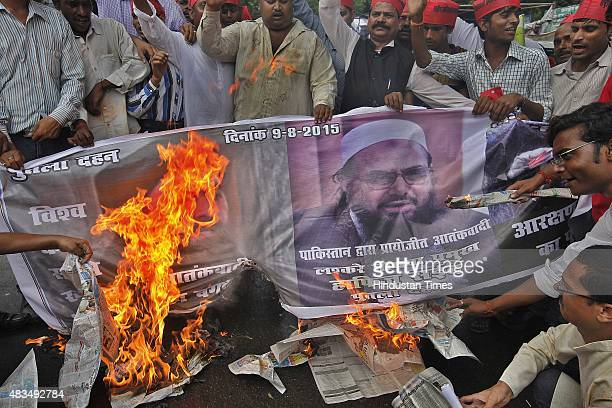 Members of Rashtriya Krantikari Samajwadi Party burn a banner with the images of IS leader Abu Bakr alBaghdadi Head of the banned Islamic charity...