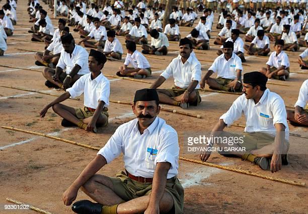 Members of Rashtriya Swayamsevak Sangh National Volunteers Organisation take part in a physical drill during a public meeting in Bangalore on...