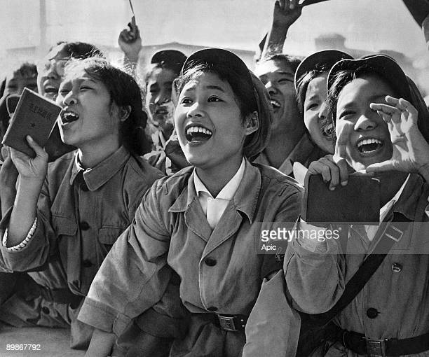 Members of red guards holding The Little Red Book cheering Mao Zedong during a meeting to celebrate the Great Proletarian Cultural Revolution on Tien...