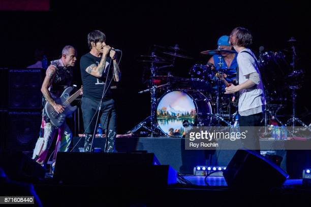 Members of Red Hot Chili Peppers Flea Anthony Kiedis Chad Smith and Josh Klinghoffer as they perform on stage during the 11th Annual Stand Up for...