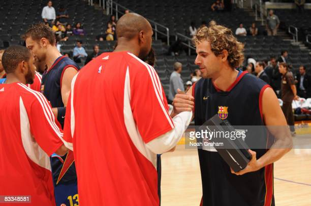 Members of Regal FC Barcelona and the Los Angeles Clippers exchange gifts before their game at Staples Center on October 19 2008 in Los Angeles...