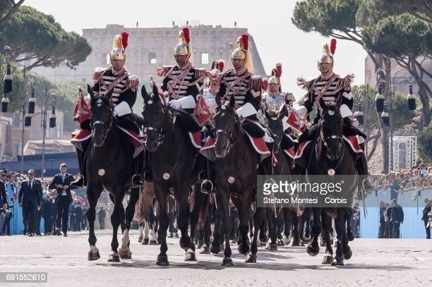 Members of Reggimento Corazzieri the Cuirassier Regiment elite military unit and the honor guard of the Italian Presiden attend the military parade...