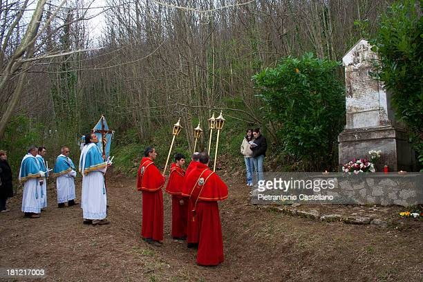 Members of religious brotherhoods of Sorrentine Peninsula reach the Memorial to the dead of plague outbreak, whose remains were incinerated and...