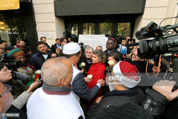 Members of religious communities speak together and with other people in front of the Bataclan concert during ceremonies across Paris marking the...